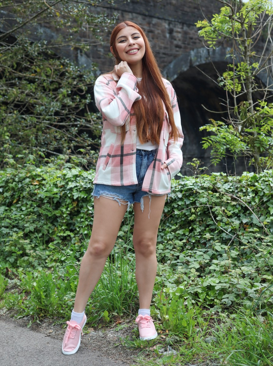 style by deb wearing femmeluxe denim shorts and pink shacket